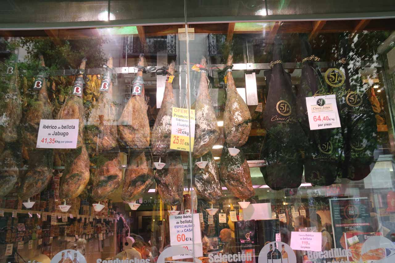 Cured meats hanging from the Museo del Jamon