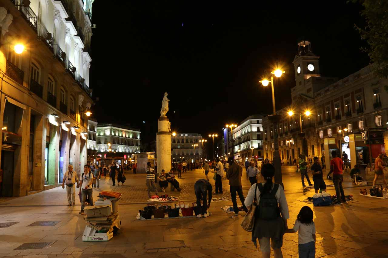 Julie and Tahia returning to the busy scene at the Puerta del Sol at night