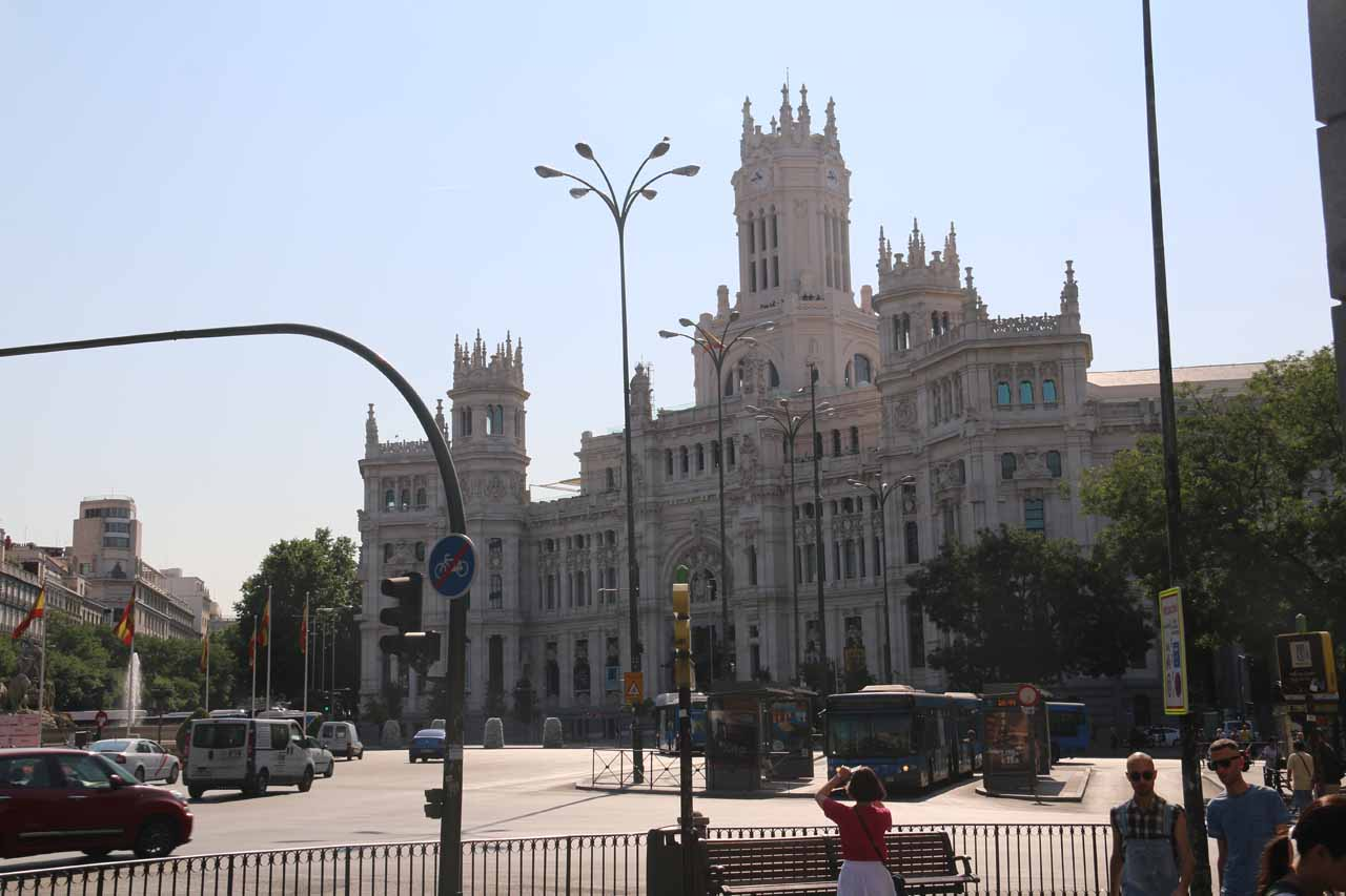 Looking across a large roundabout towards the Palacio de Cibeles