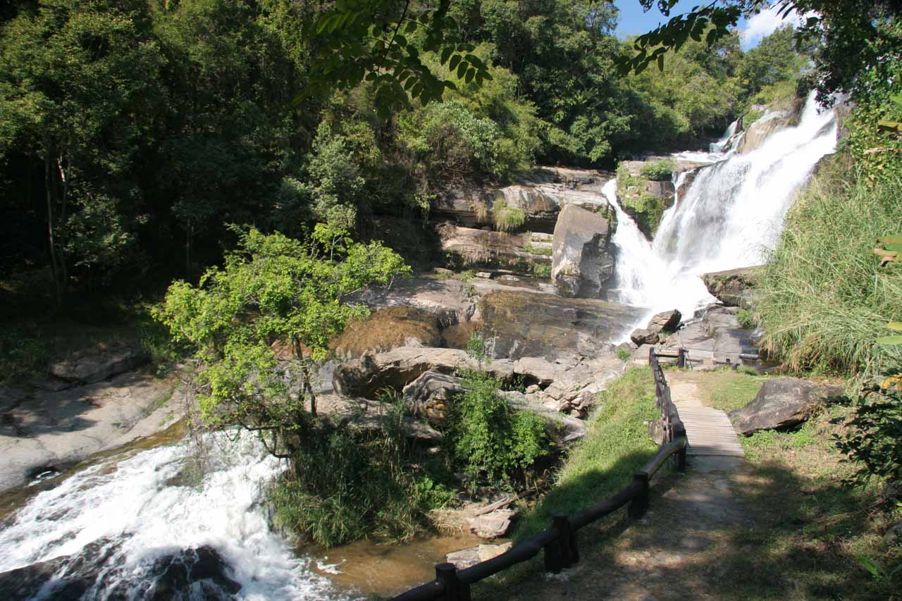 Full contextual view of the Mae Klang Waterfall showing some of its lower tiers plus the walkway leading to its end