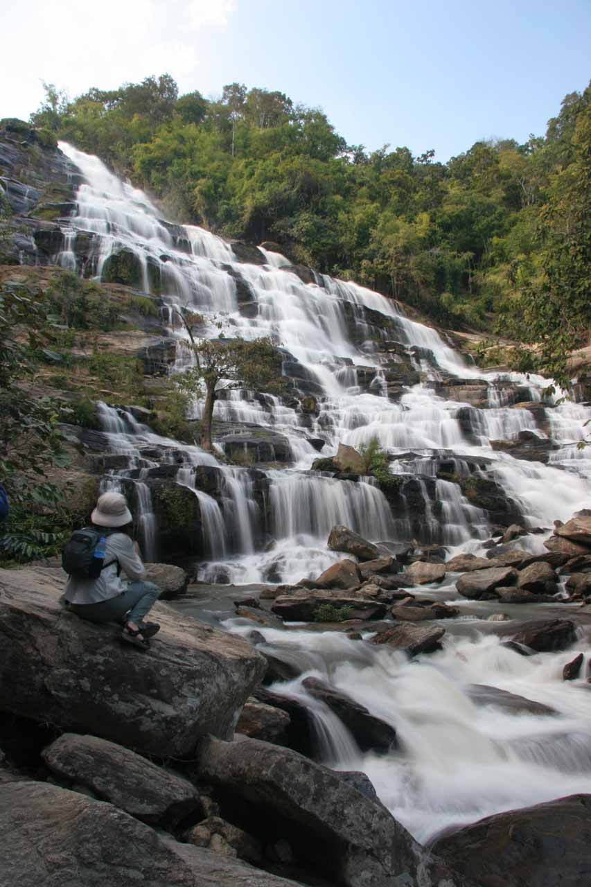 Julie having a seat and checking out the impressive Mae Ya Waterfall