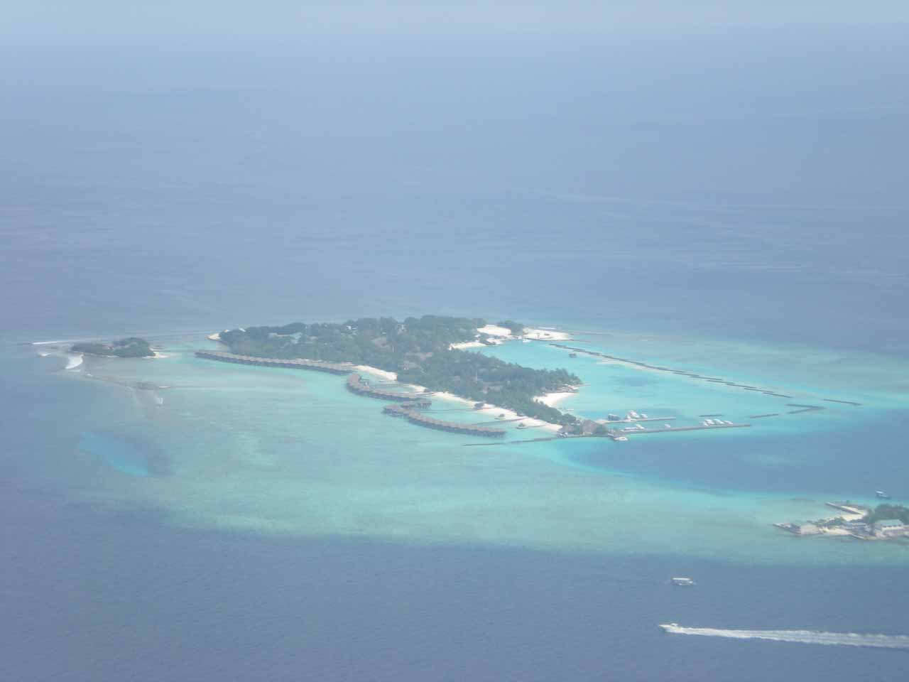Looking out the plane towards some atoll on the way to the Maldives