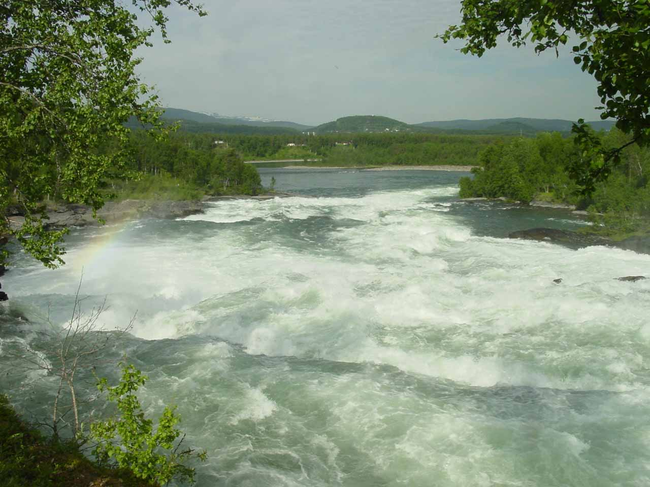 Looking downstream from Målselvfossen with a slight rainbow