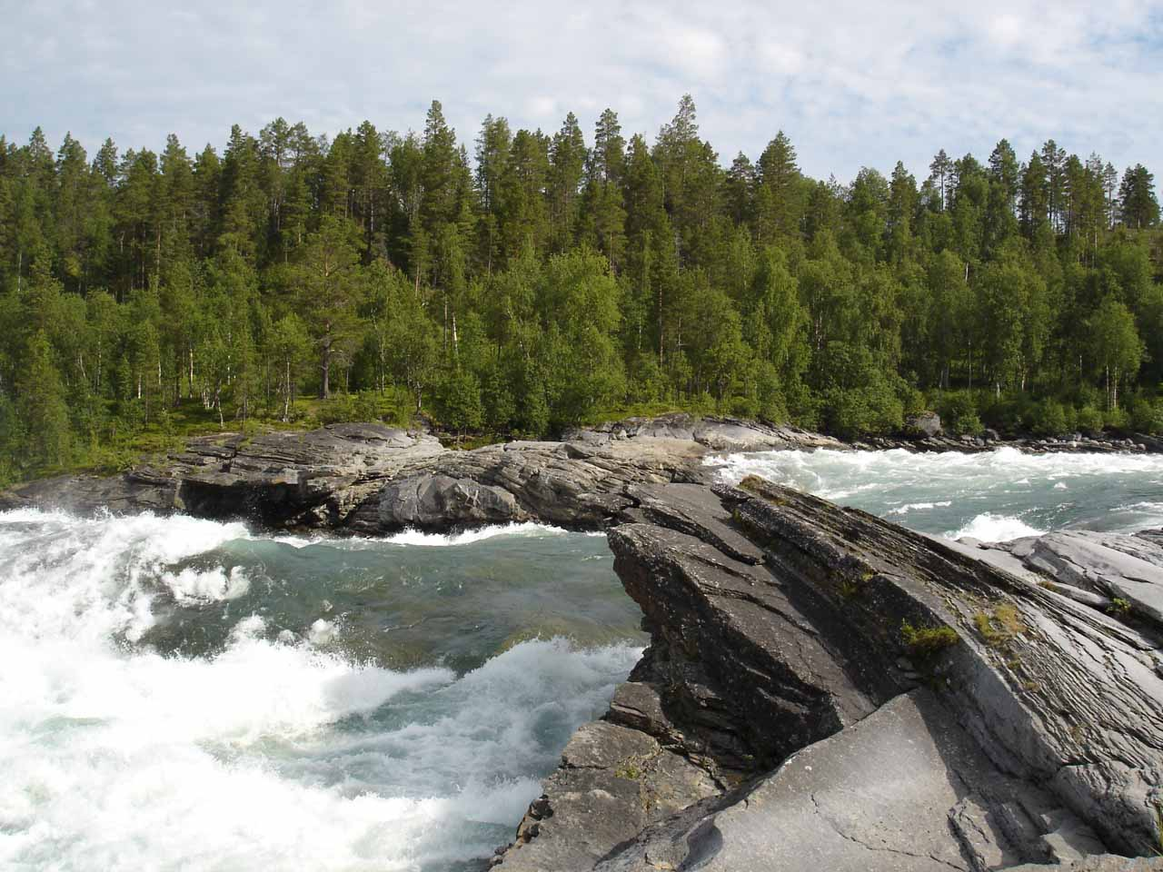 Jagged rocks flanking the top of the rapids of Målselvfossen