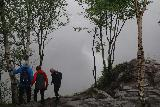 Manafossen_070_06202019 - Context of a trio of people checking out the lookout of Månafossen when the clouds already shrouded the waterfall during our visit in June 2019