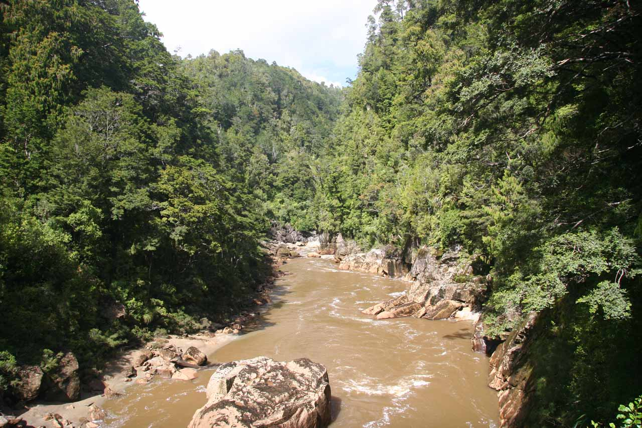 Looking downstream on the Ngakawau River while standing in the middle of the long swinging bridge