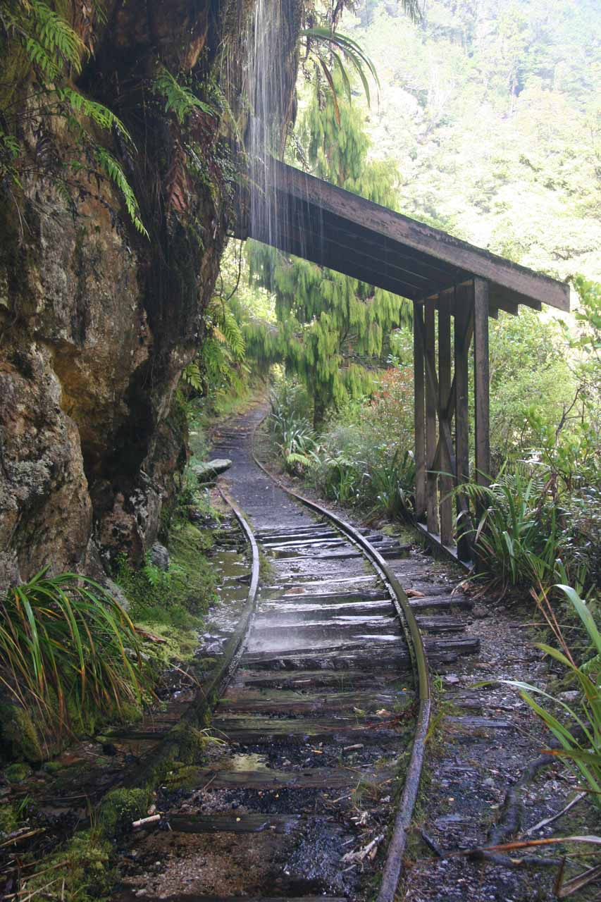 Going beneath a weeping wall before a shelter at a bend in the railroad tracks