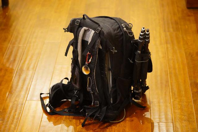I appreciated the external front-side loops (one of which is bungy-tied) on the Osprey Manta 34 Backpack for holding my tripod without sacrificing the side pockets (note the retractable mirror is my own carabiner attachment)