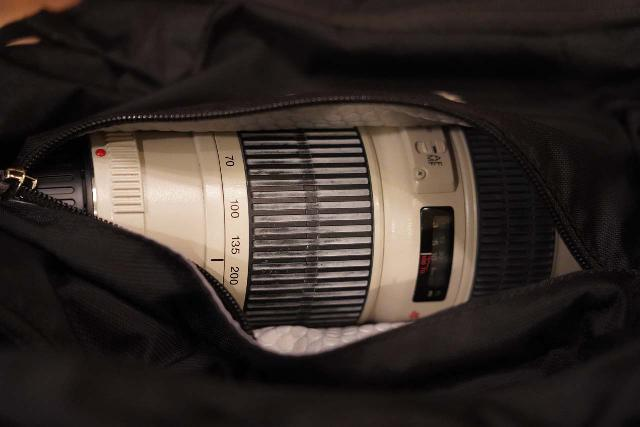 The Osprey Manta 34's slash pocket barely fits my 70-200mm telephoto lens without the lens hood