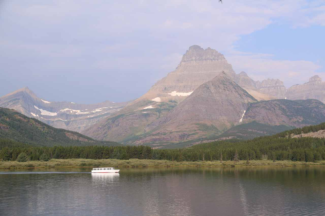 Context of the boat on Swiftcurrent Lake fronting Mt Wilbur and the Iceberg Notch