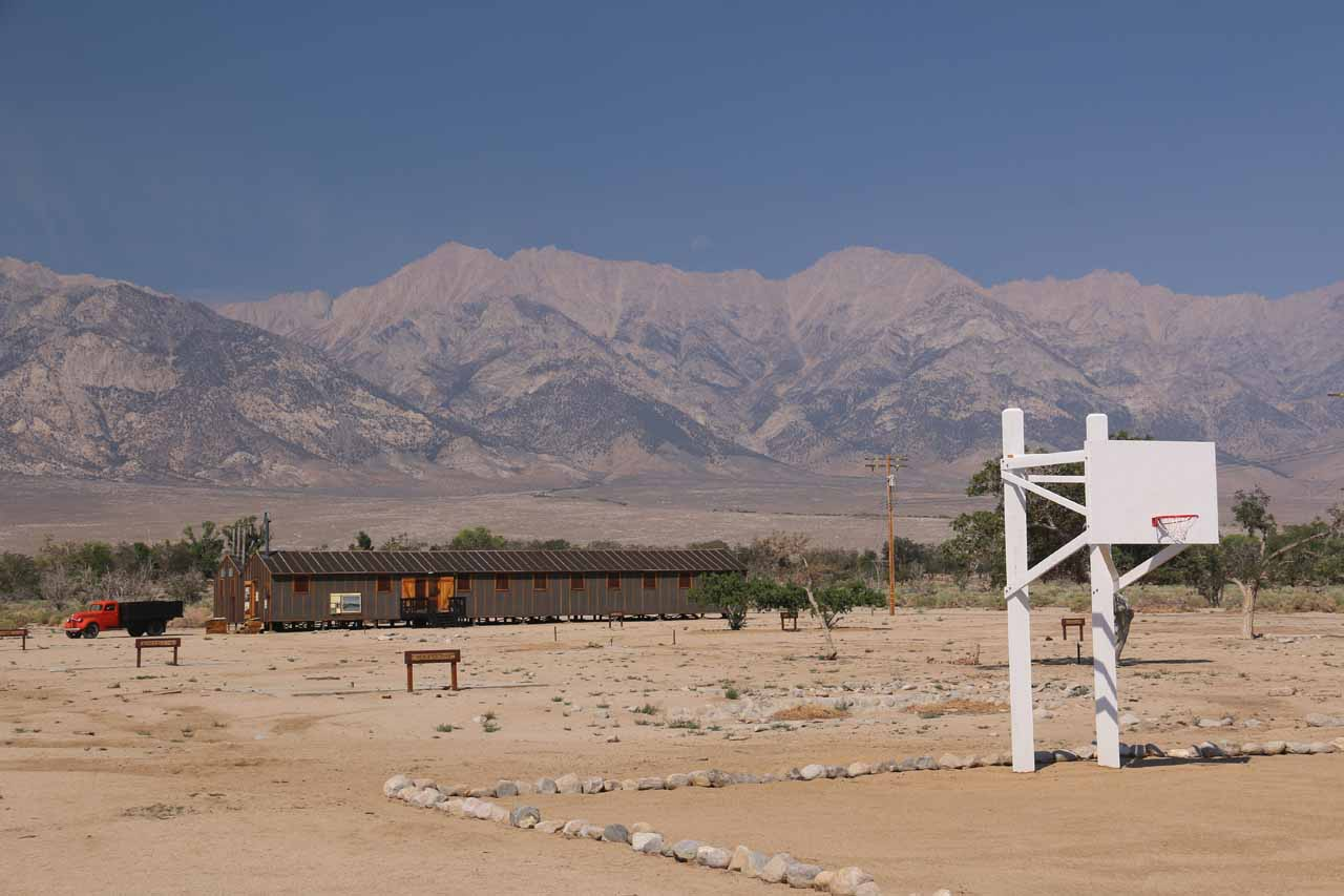 Looking towards the Mess Hall and basketball court before the Eastern Sierra Mountains at Manzanar