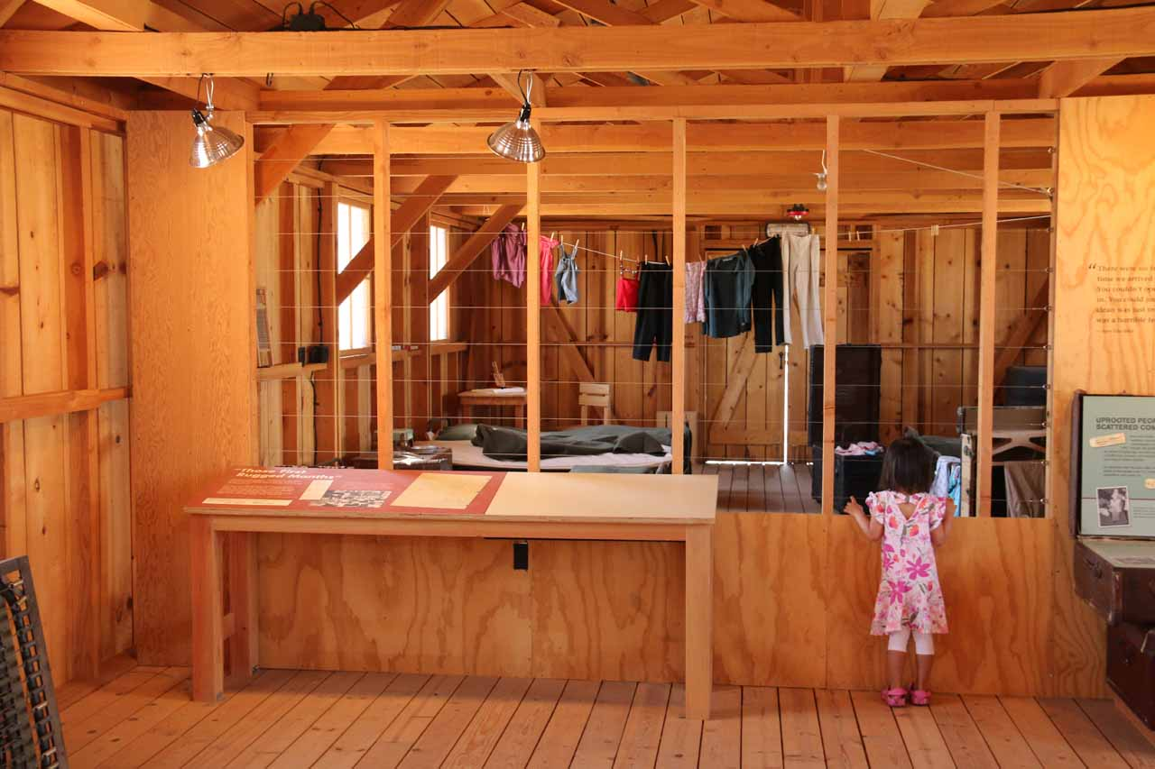Tahia looking inside at other living quarters inside Manzanar