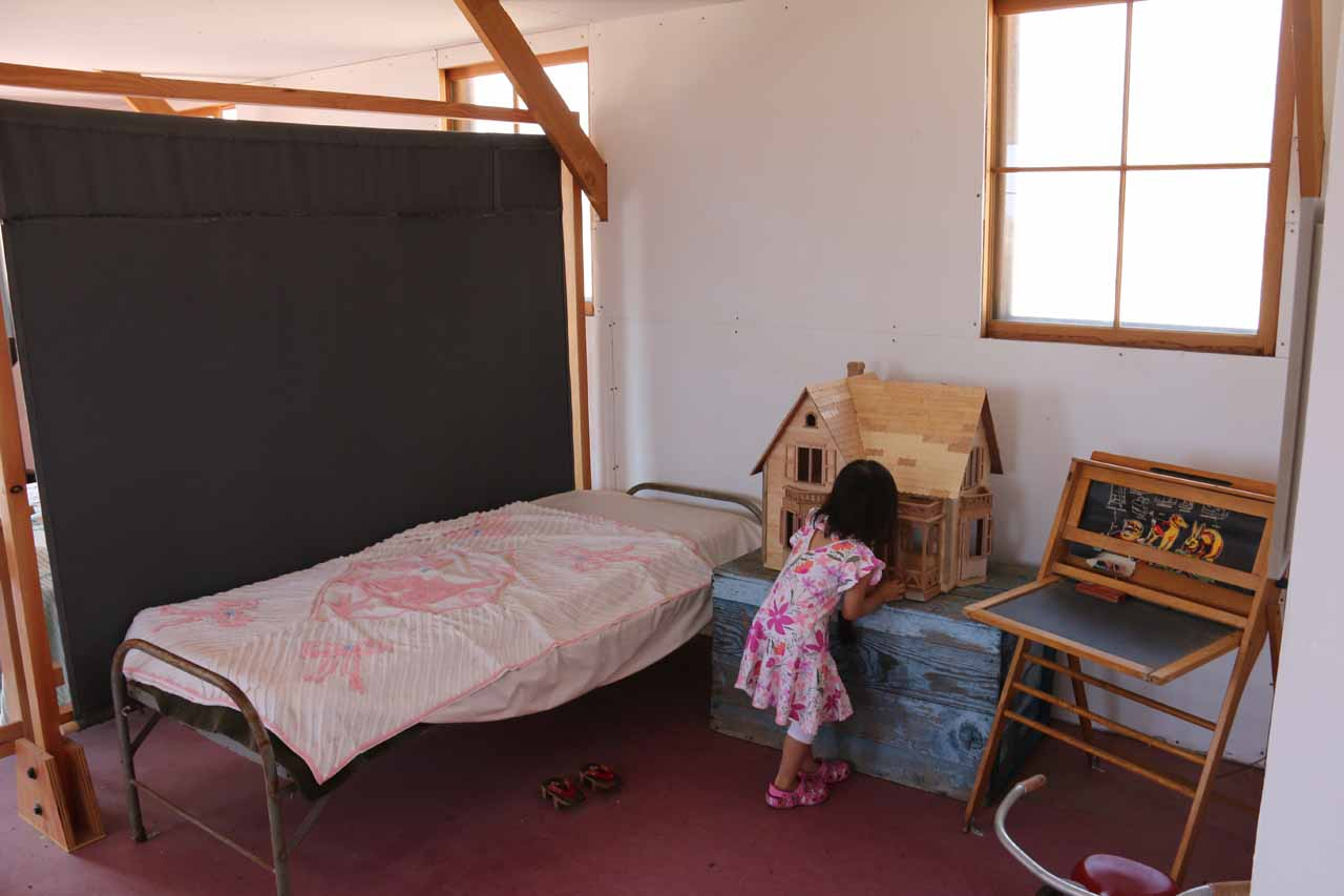 Tahia checking out some of the re-creations of kids quarters at Manzanar