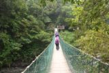 Maolin_Valey_Waterfall_027_10292016 - Mom following the purple-shirted hiking group across the first suspension bridge en route to the Maolin Valley Waterfall