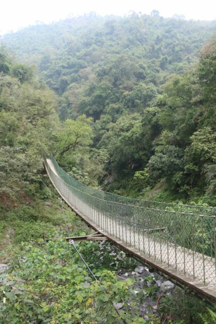 Maolin_Valey_Waterfall_031_10292016 - Traversing the first of the swinging bridges on the trail to the Maolin Valley Waterfall