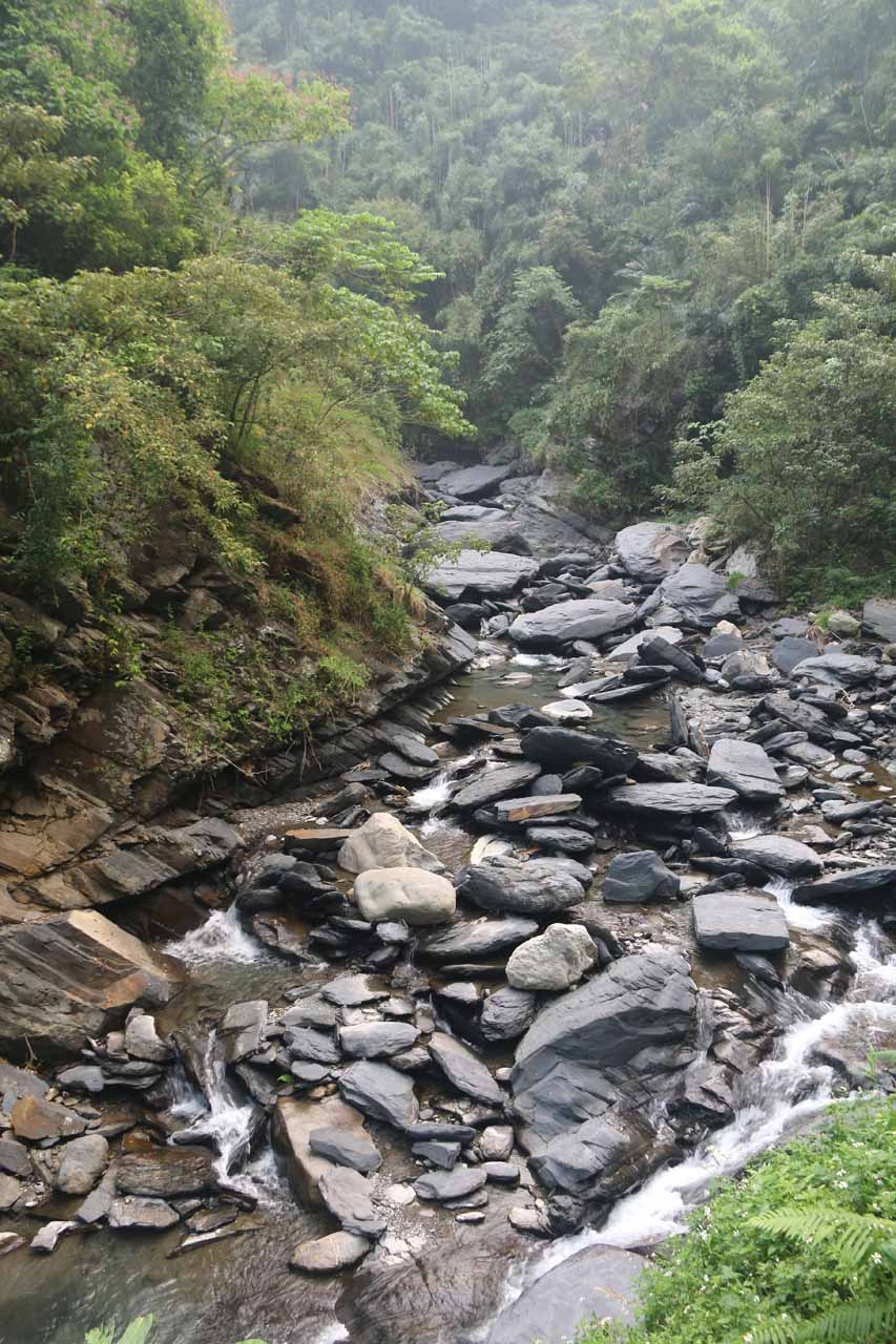 Looking upstream at the rocky streambed from the second suspension bridge