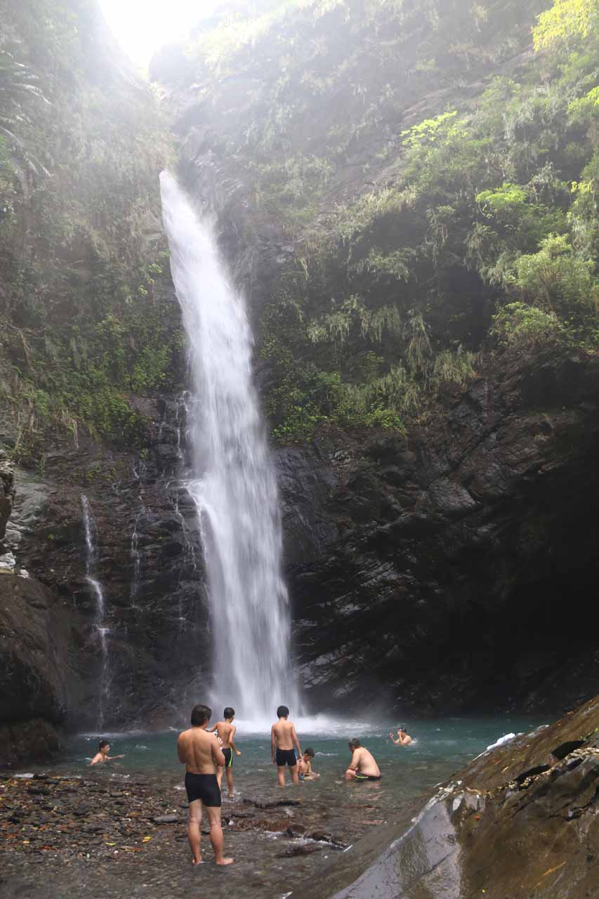 Lots of folks enjoying a well-earned cooling off in the plunge pool at the Maolin Valley Waterfall