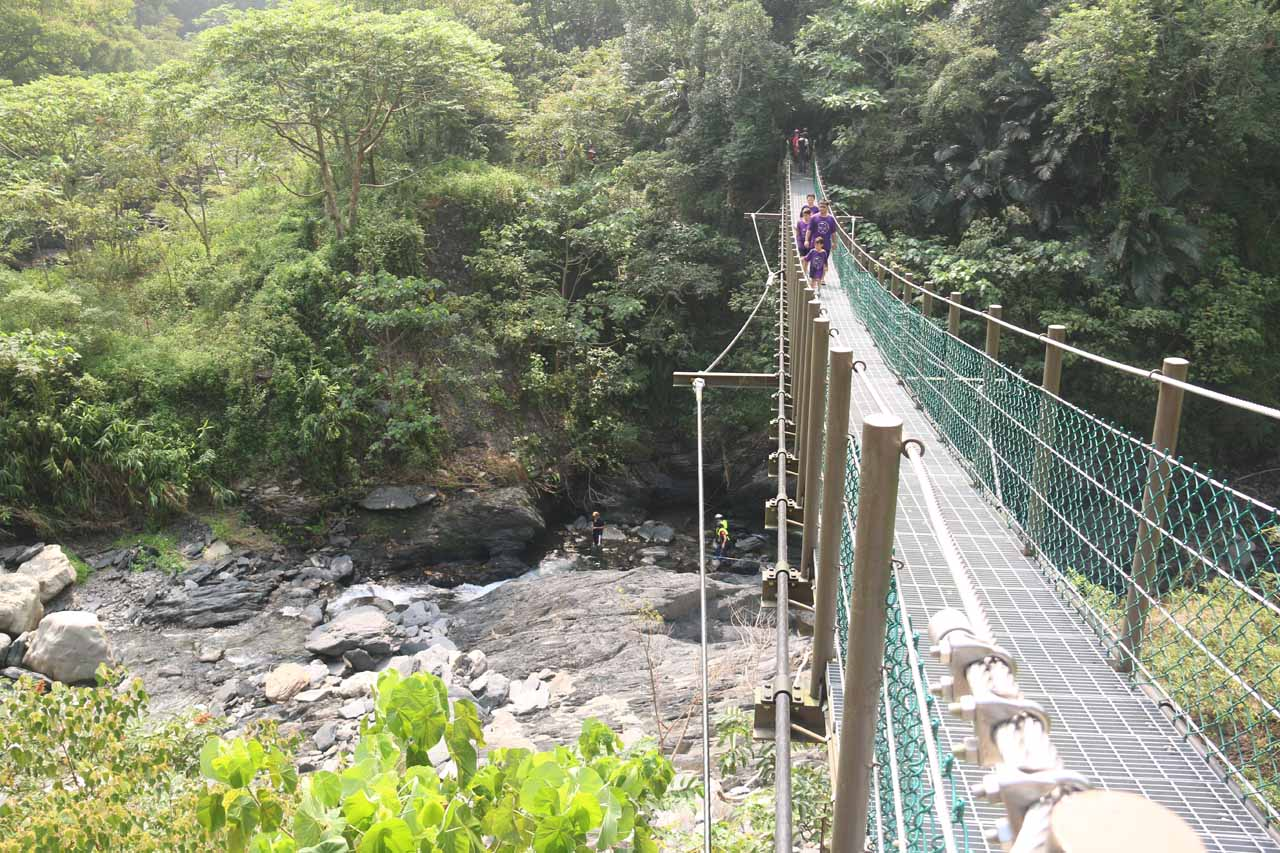 Crossing over a suspension bridge on the return hike. If you look closely, you might see people river tracing beneath the bridge