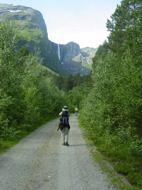 Mardalsfossen_005_07032005 - Julie passed by a mountain biker in the first 800m of the hike towards Mardalsfossen as seen back in early July 2005. I wasn't sure mountain bikers could do this trail anymore when I came back in July 2019