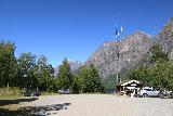 Mardalsfossen_015_07162019 - Looking towards the far end of the car park for Mardalsfossen with a kiosk as well as a hint of Eikesdalsvatnet