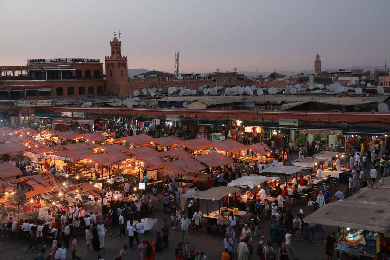Looking towards the UNESCO World Heritage square of Djemaa el-Fna in the medina of Marrakech with its atmospheric mix of snake charmers, entertainment, souks, and food stands