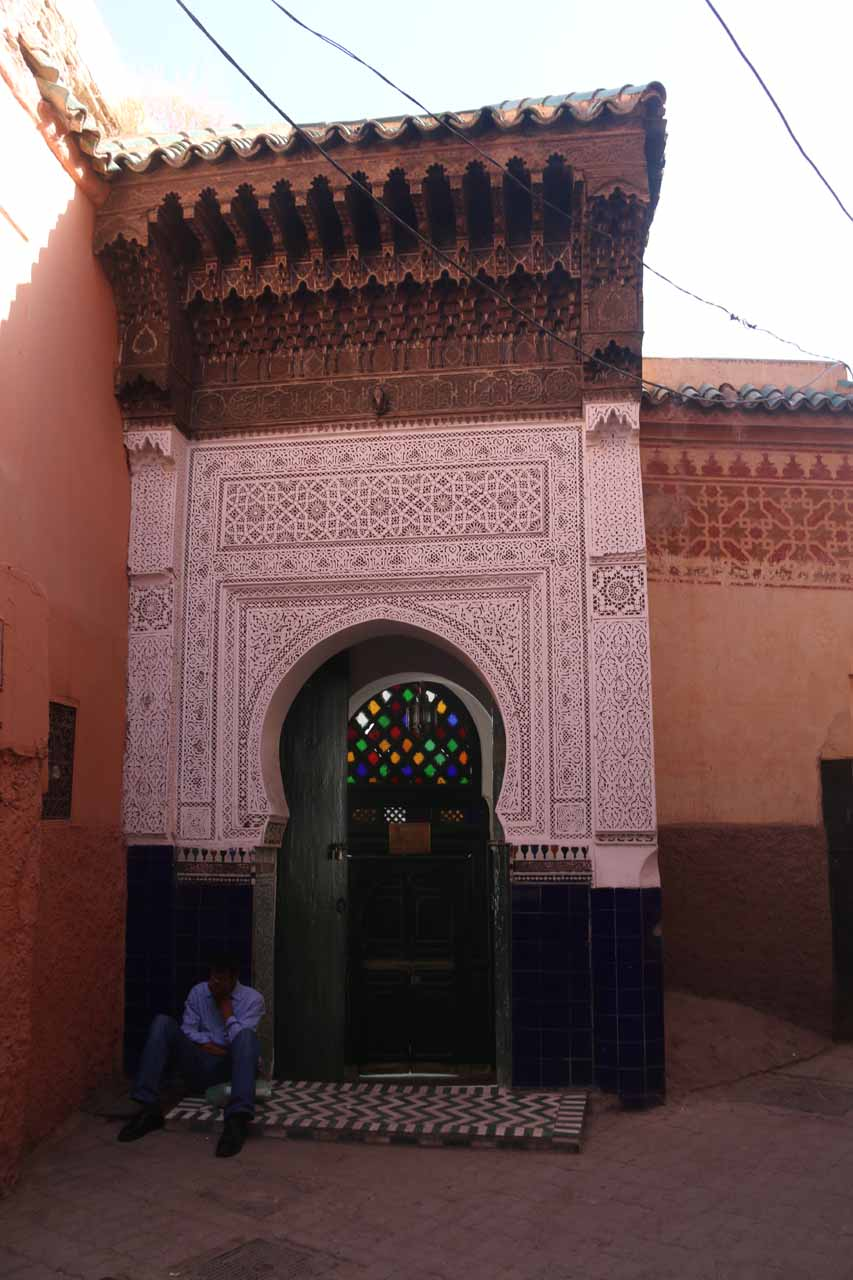 Passing by an elaborate Arabic arched doorway on the way to Ben Youssef Medersa