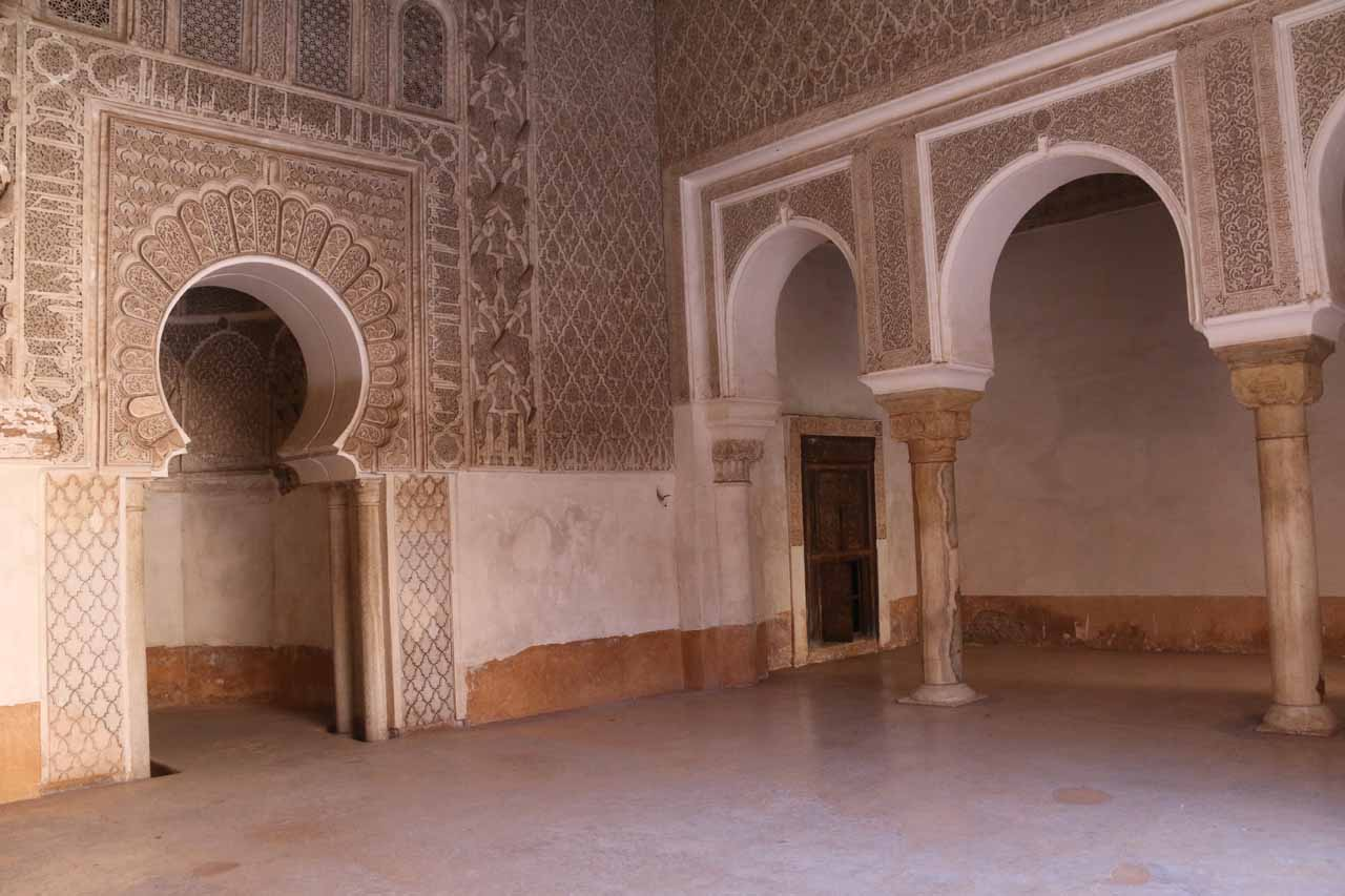 Arabic arches surrounding one of the side rooms besides the courtyard at Ben Youssef Medersa