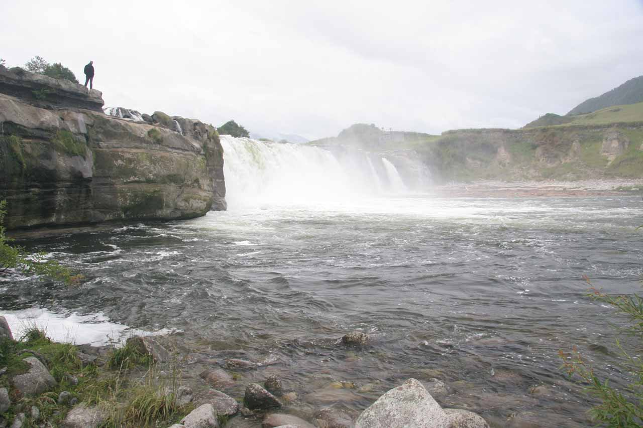 A guy who managed to scramble to get right to the brink of Maruia Falls