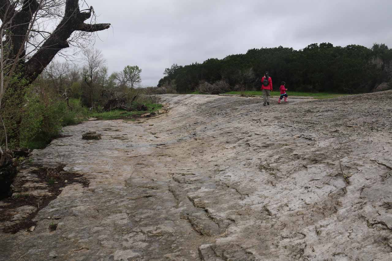 Tahia and Julie going back up the limestone slope before returning to the car