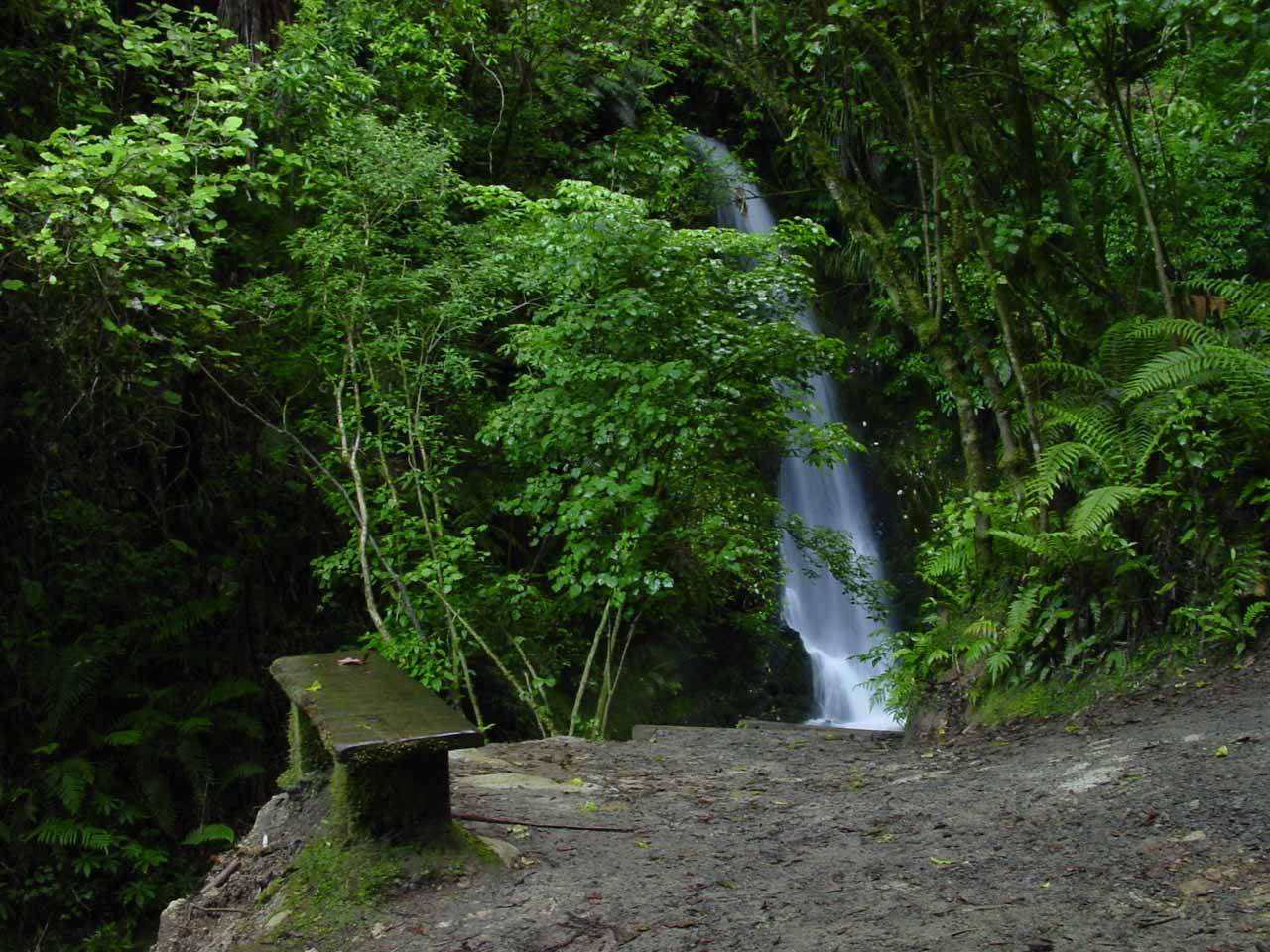 A rest bench with Marshall Falls