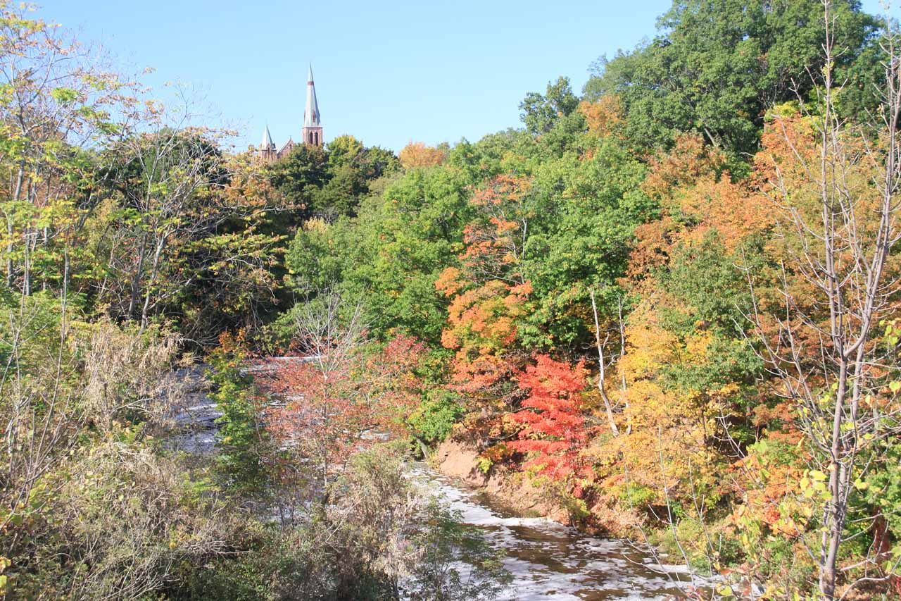Looking downstream from Medina Falls amongst the colorful foliage towards what appeared to be a church in the distance