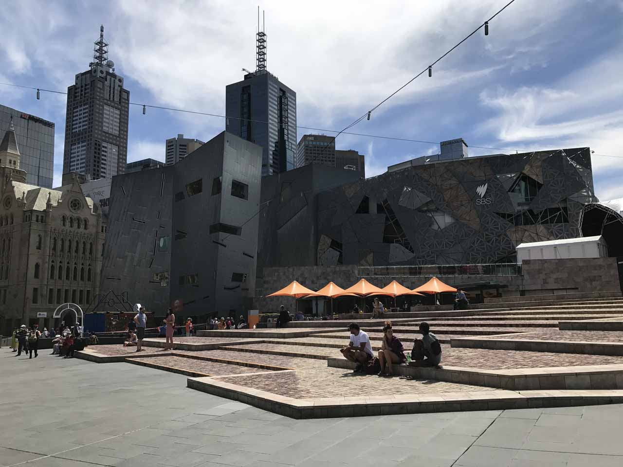 One of the popular hangout spots in the Melbourne CBD was Federation Square which was surrounded by the St Paul Cathedral to the north, Flinders Station to the west, and the Yarra River to the south