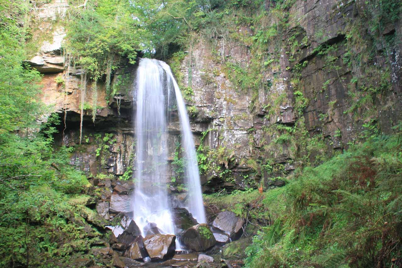 Landscape view of Melincourt Falls showing the surrounding cliffs