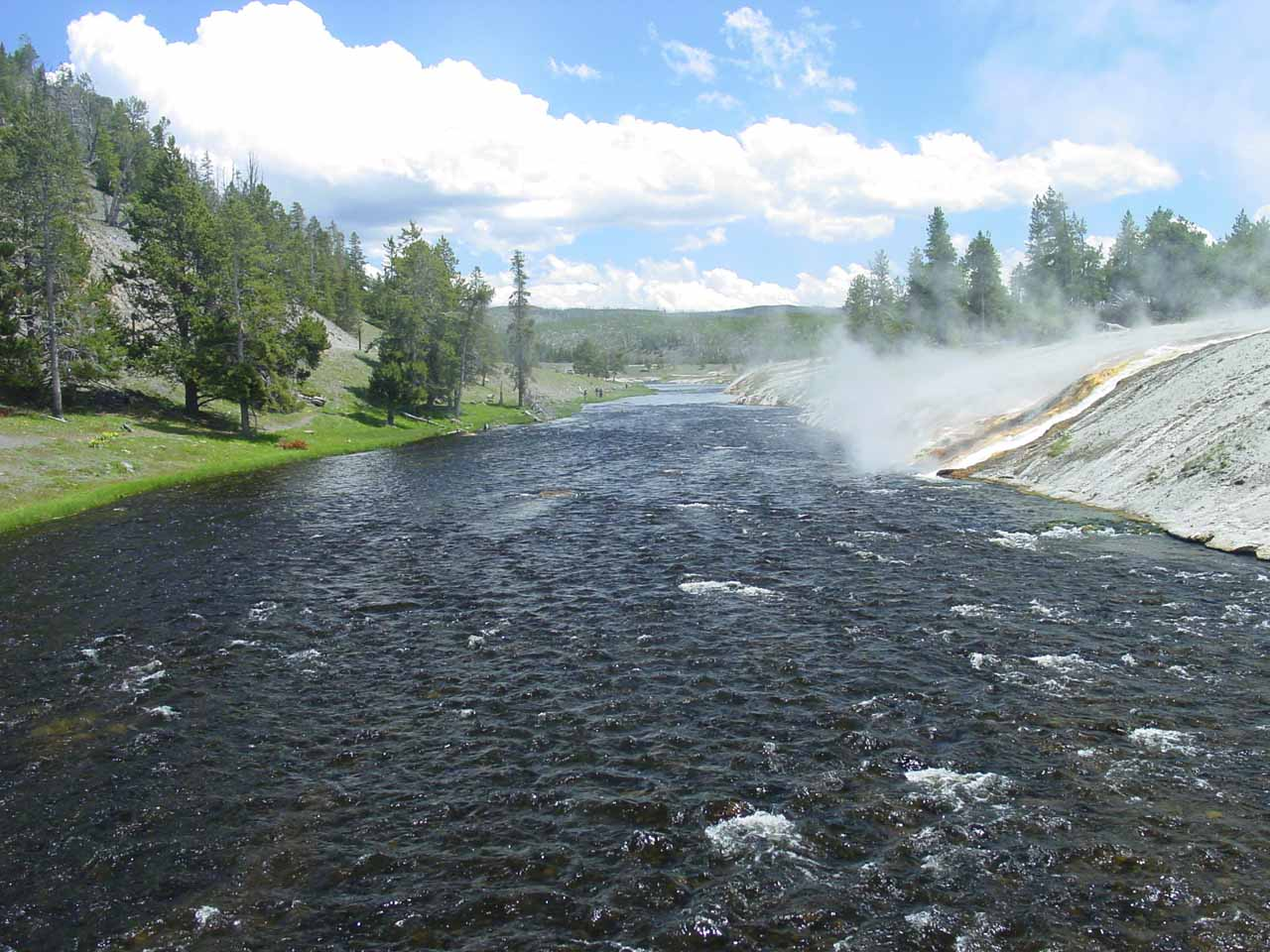 Some thermal cascades spilling into the Firehole River by Excelsior Geyser