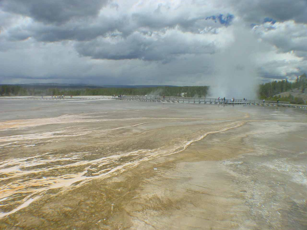 Looking across some beige mats near the Grand Prismatic Spring