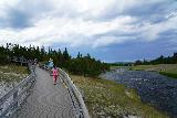 Midway_Geyser_Basin_052_08032020 - Julie and Tahia following the busy boardwalk at the Midway Geyser Basin with a looming thunderstorm seemingly getting closer by the minute on our August 2020 visit