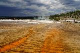 Midway_Geyser_Basin_090_08032020 - Looking downstream from the Grand Prismatic Spring towards the direction of the Excelsior Geyser with a dark thunderstorm looming in the distance during our August 2020 visit