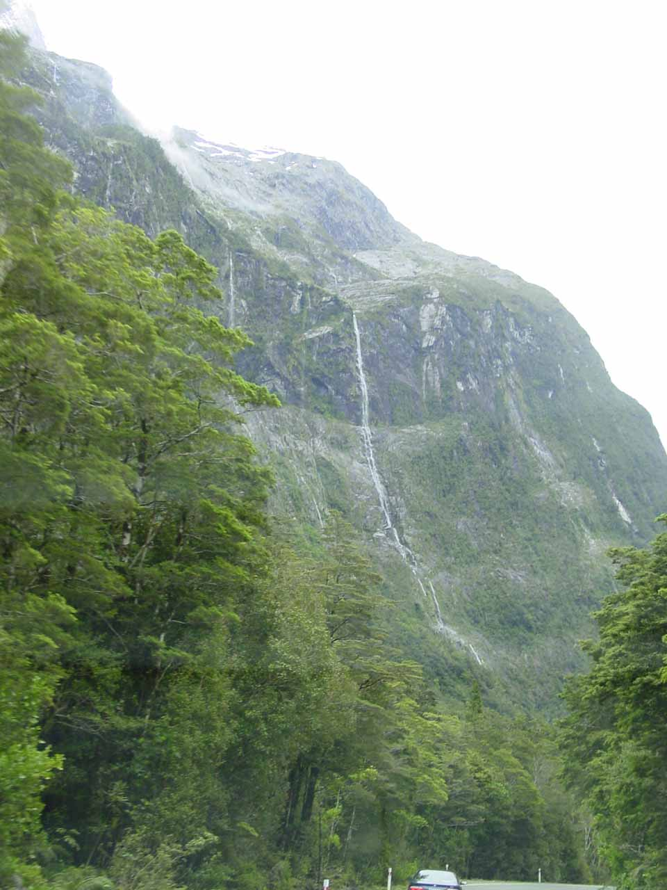 A series of tall ephemeral waterfalls somewhere not far from the Chasm along the Milford Highway