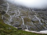Milford_Sound_004_jx_12242009 - Here was a look at how waterfalls could come down like veins around the Milford Sound Highway.  This occurred after a clearing storm in December 2009