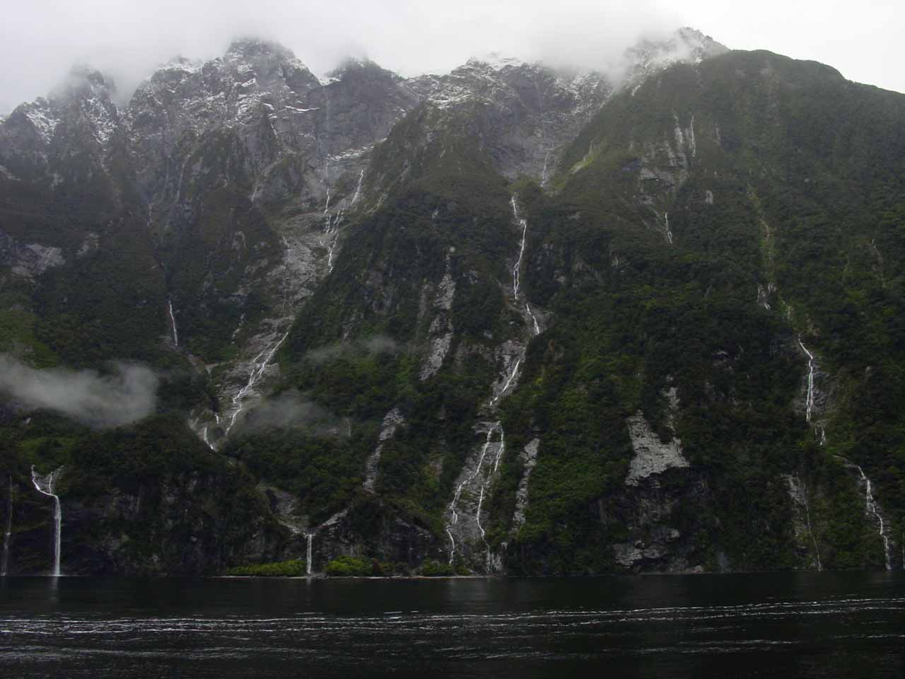 Looking across the fiord from its north side at the context of both Fairy Falls and Bridal Veil Falls