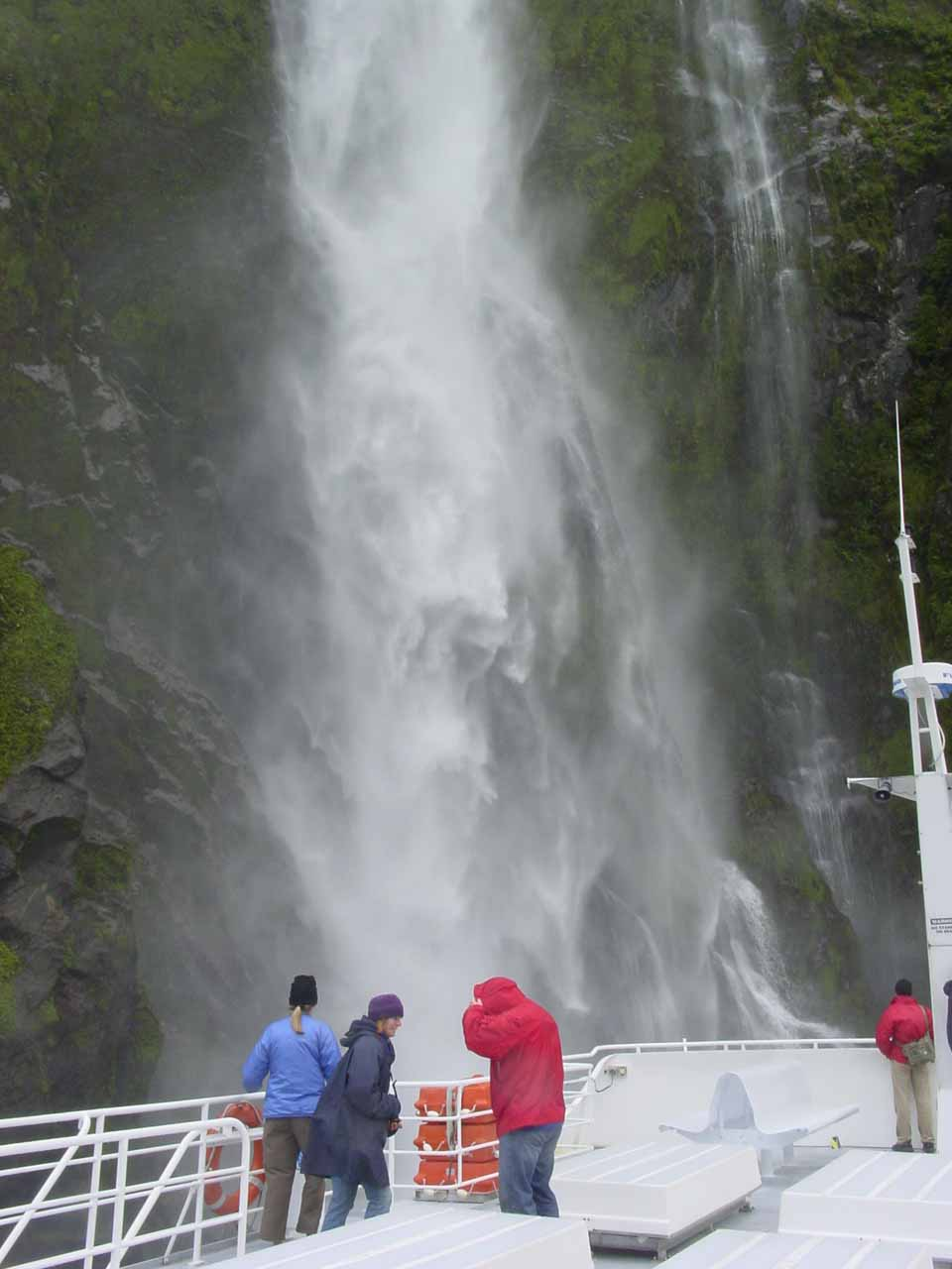 Some people were preparing to get wet as our 2004 cruise vessel was approaching Stirling Falls
