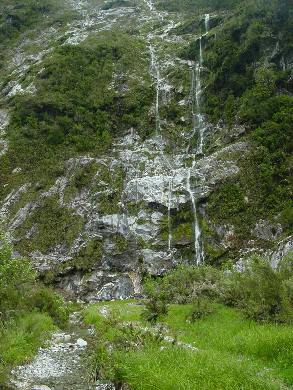 Looking back at a pair of ephemeral waterfalls near the Hidden Lake spur