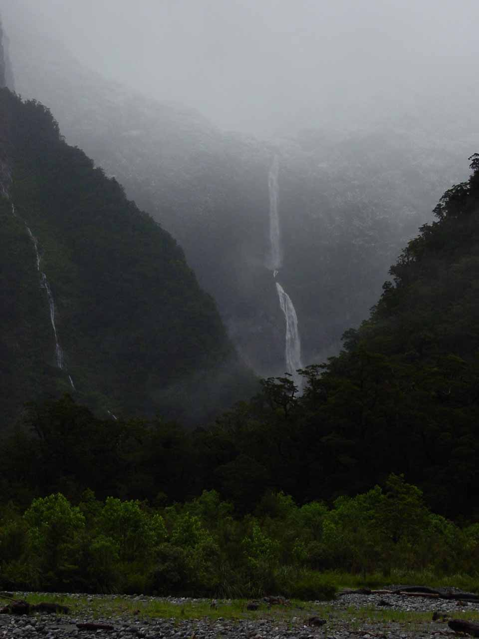 Distant view of Sutherland Falls shrouded in rain clouds from the Milford Track on Day 4
