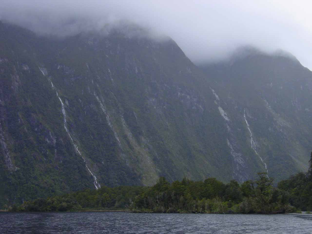 Looking across at some stringy ephemeral waterfalls lining Milford Sound