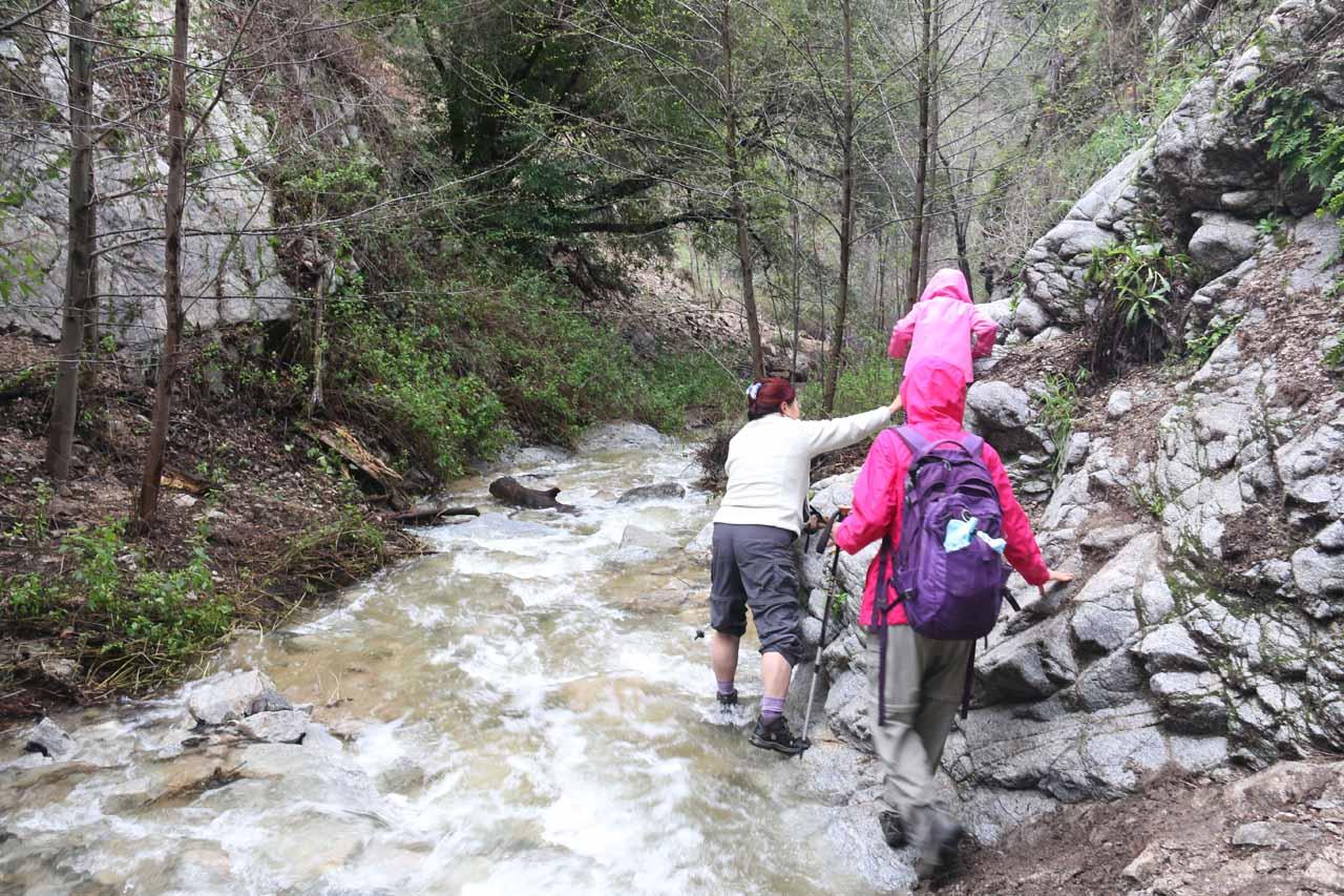 Mom helping Tahia get by one of many crossings of a swollen Millard Creek