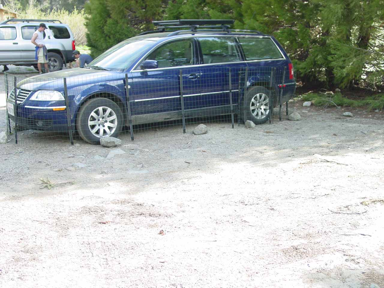 A car with a wire fence around it