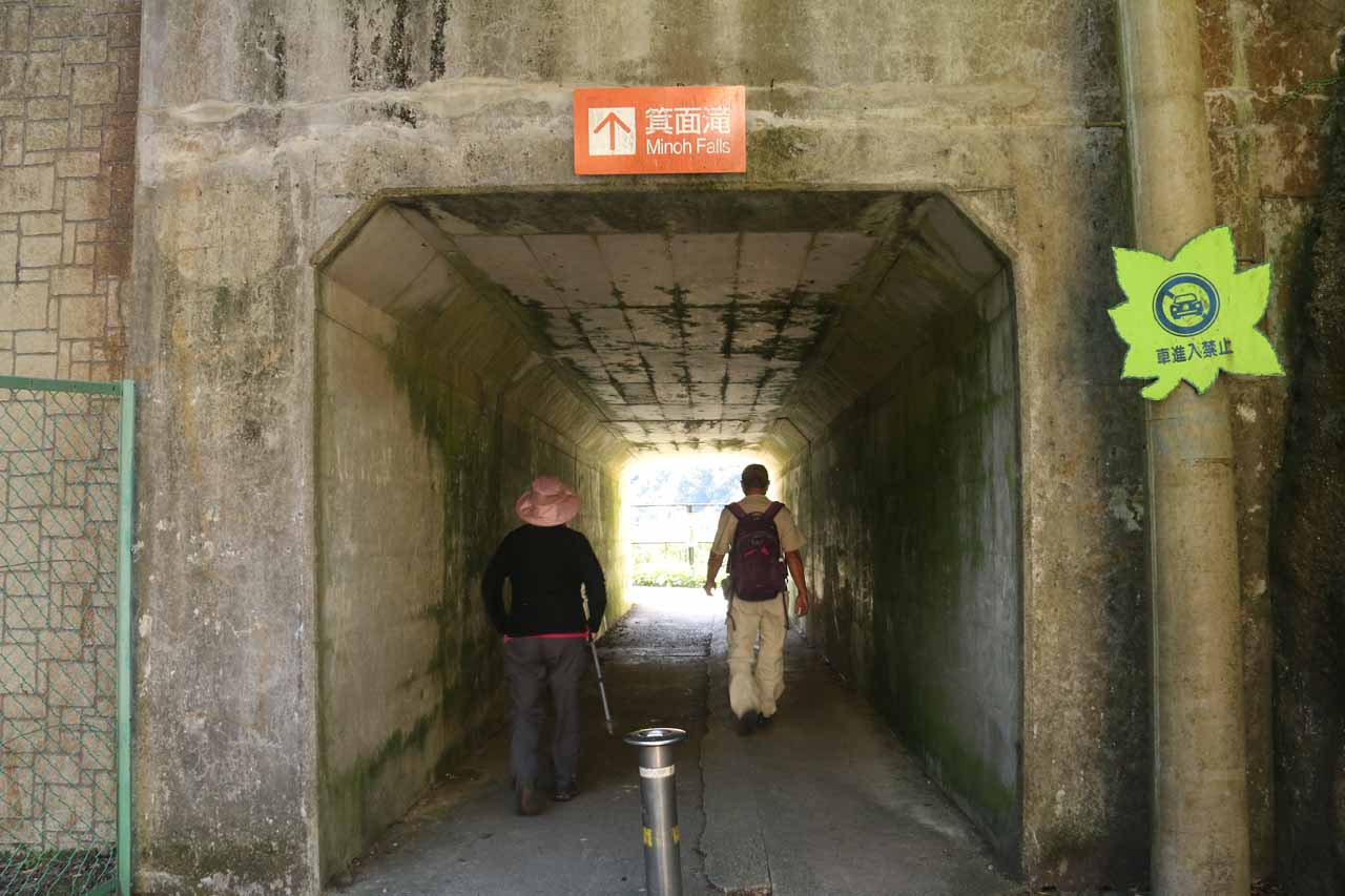 Dad and Mom passing through the tunnel near the top of Minoh Falls