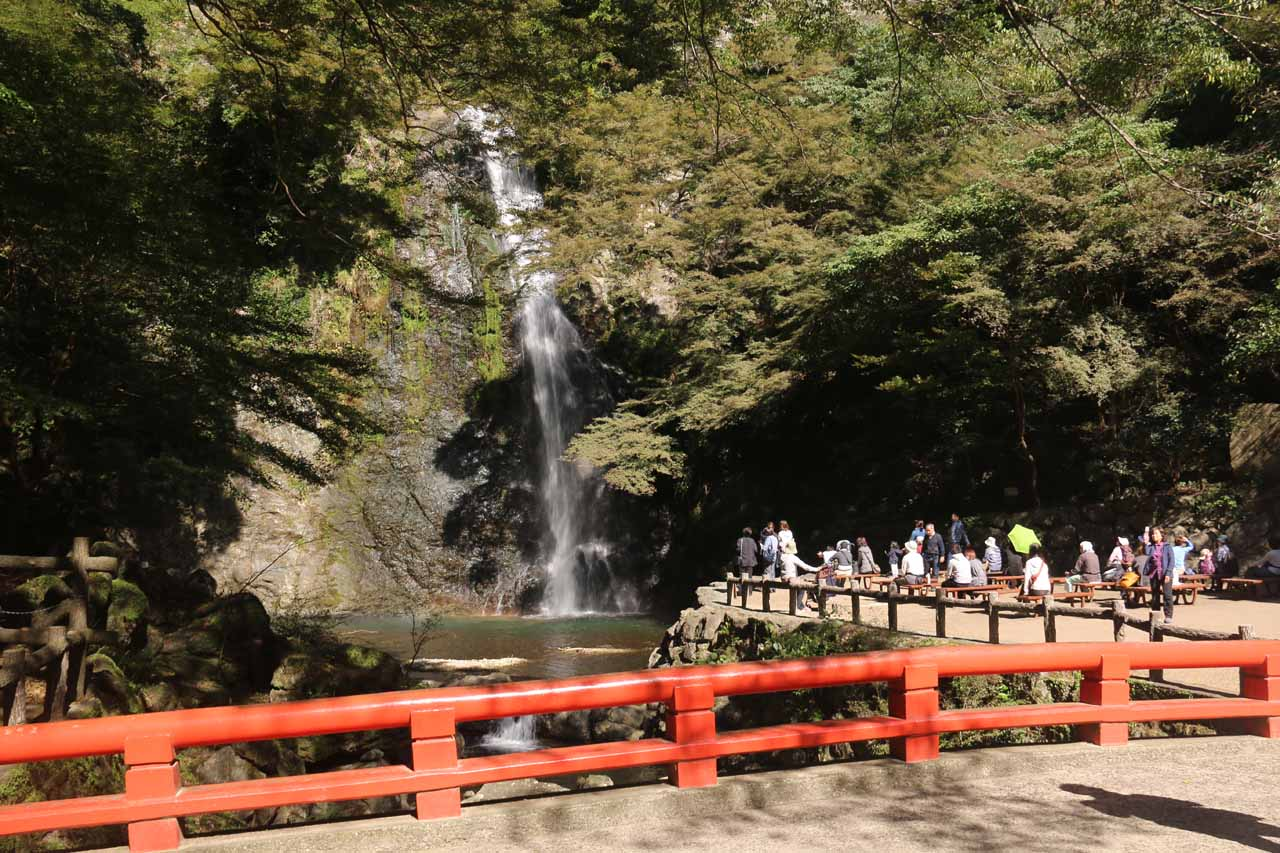 View of the impressive Minoh Waterfall and viewing area from the red-railed bridge over the Minogawa