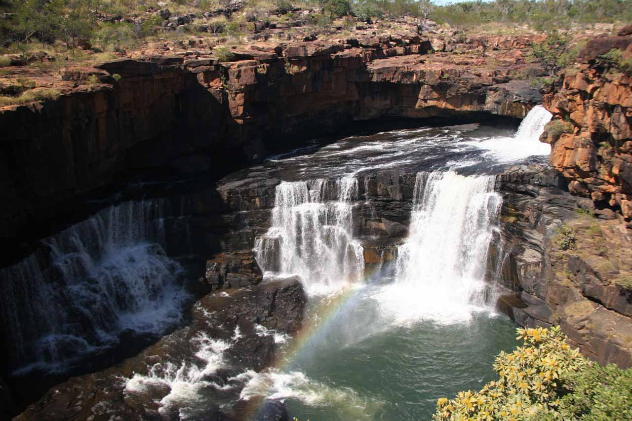 Rainbow going across the uppermost tiers of Mitchell Falls