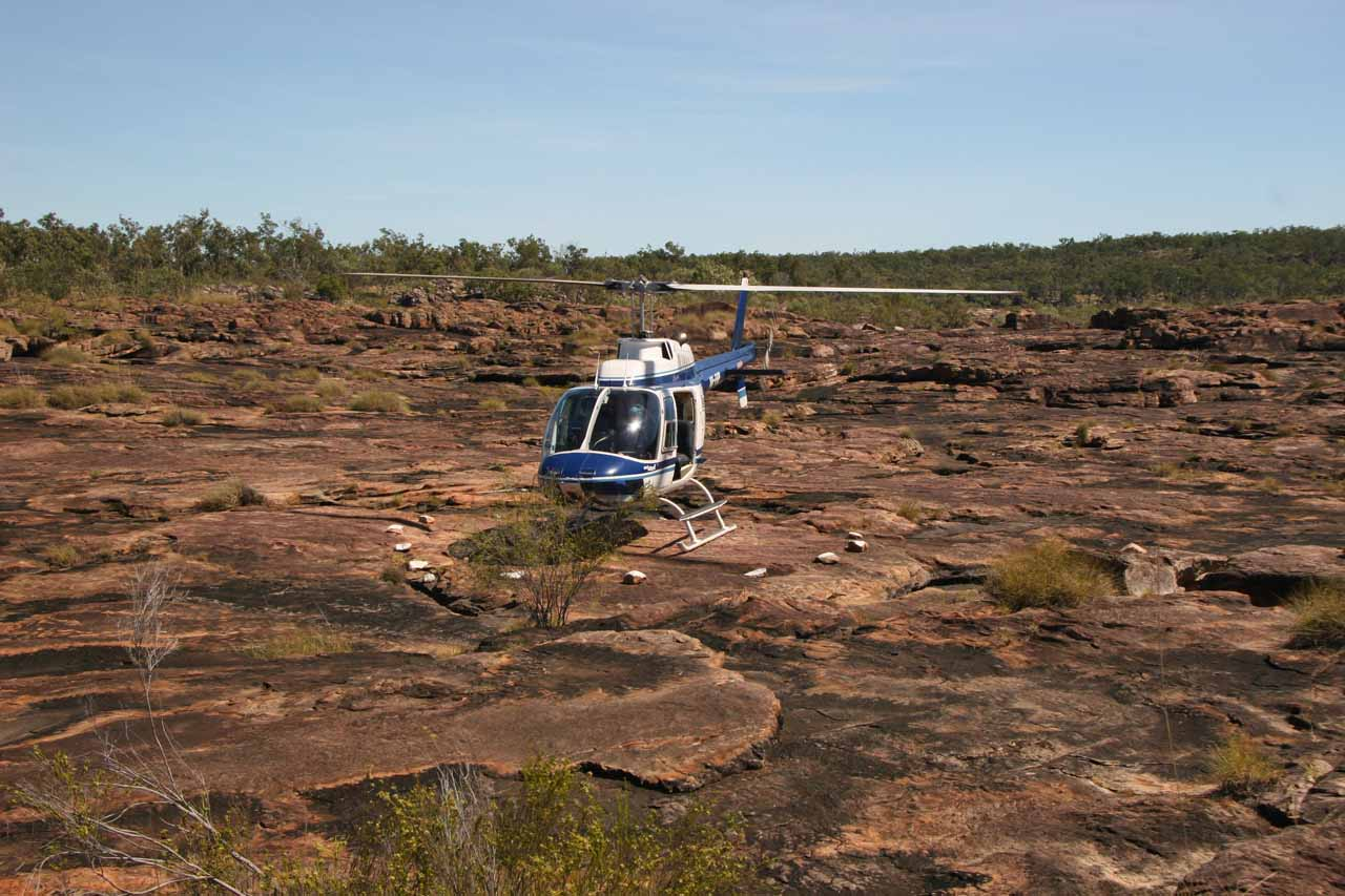 Helicopter on the makeshift helipad above Mitchell Falls